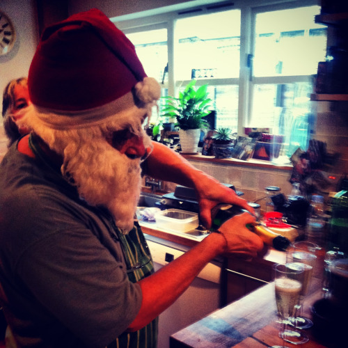 Father Christmas handing out drinks.   London 2012.