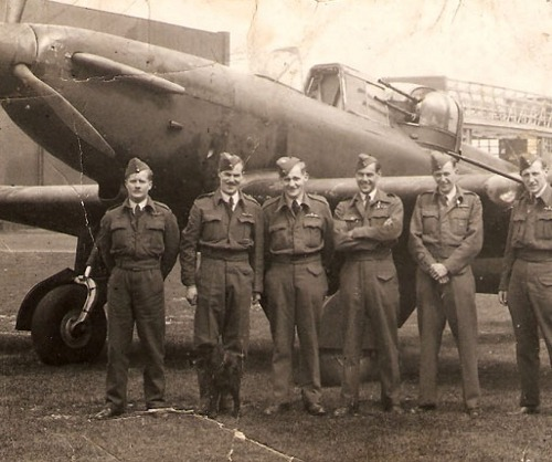 """A group of pilots on a Boulton Paul Defiant Squadron pose with their Squadron Mascot at RAF Driffield."" (via)"