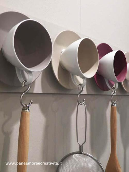 Teacup & Saucer combination as creative kitchen utensil hangers http://on.fb.me/13JUmGs