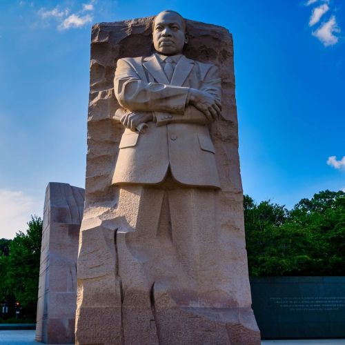"""The Martin Luther King, Jr. Memorial is located in West Potomac Park next to the National Mall in Washington, D.C., United States.   It covers four acres (1.6 ha) and includes the Stone of Hope, a granite statue of Civil Rights Movement leader Martin Luther King Jr. carved by sculptor Lei Yixin. The inspiration for the memorial design is a line from King's """"I Have A Dream"""" speech: """"Out of the mountain of despair, a stone of hope."""" The memorial opened to the public on August 22, 2011, after more than two decades of planning, fund-raising, and construction.   This national memorial is the 395th unit in the United States National Park Service. The monumental memorial is located at the northwest corner of the Tidal Basin near the Franklin Delano Roosevelt Memorial, on a sightline linking the Lincoln Memorial to the northwest and the Jefferson Memorial to the southeast.   The official address of the monument, 1964 Independence Avenue, S.W., commemorates the Civil Rights Act of 1964.   A ceremony dedicating the memorial was scheduled for Sunday, August 28, 2011, the 48th anniversary of the """"I Have a Dream"""" speech that Martin Luther King Jr. delivered from the steps of the Lincoln Memorial in 1963 but was postponed until October 16 (the 16th anniversary of the 1995 Million Man March on the National Mall) due to Hurricane Irene.   Although this is not the first memorial to an African American in Washington, D.C., King is the first African American honored with a memorial on or near the National Mall and only the fourth non-President to be memorialized in such a way.   #SayTheirNames #NeverForget #NeverForgotten #flagsofhonorescorts #rollcallflag #projectrollcall   #america #armedforces #fallen #fallenheroes #freedom #heroes #honor #merica #respect #salutethefallen #soldiers #supportourtroops #tactical #usa #military #warriors #army #usveterans #usmilitary #airforce #mission_22 #22aday #veterans   Projectrollcall.org https://www.instagram.com/p/CK4a5KzLU0C/?igshid=j8v1wxwqul"""