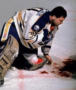 makaveli-soldier:   Clint Malarchuk mere moments after having his jugular vein severed by a teammates skate blade during a game on March 22, 1989.  It was his carotid artery. The team's trainer Jim Pizzutelli, a former Vietnam Army medic save his life by reaching into Malarchuk's neck and pinched off the bleeding, not letting go until doctors arrived to begin suturing the wound. Also out of the people who wittnessed the gory incident; 11 fans fainted, 2 more suffered heart attacks and 3 players vomited on the ice.