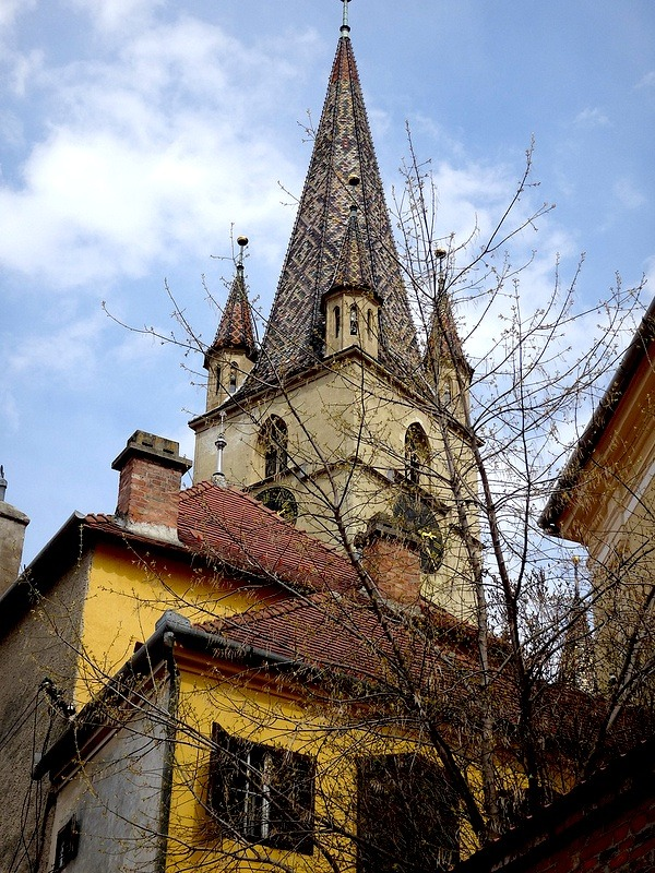 | ♕ |  Gothic Belfry - Sibiu, Romania  | by © TheWildNene Biserica Evangelica/the Evangelical Cathedral: This impressive structure, featuring five pointed towers, was built in 1520 on the site of an old Roman basilica. The simple, stark interior is in total contrast to that of the Catholic Church.  [Ref. RomaniaTourism.com/Sibiu]