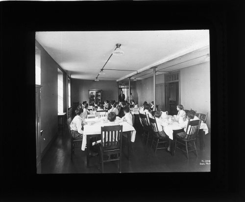 Boys in dining room, Suffolk School for Boys, Rainsford Island, circa 1910-1920, Institutions Department lantern slides (Collection #8500.002)  This work is free of known copyright restrictions. Please attribute to City of Boston Archives For more images from this collection, click here