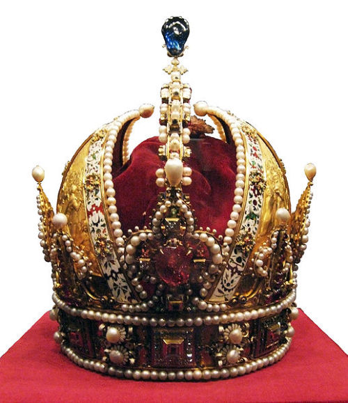 historysquee:  Imperial Crown of Austria This is the crown that was worn by the Holy Roman Emperors from its creation, in 1602, until the Holy Roman Empire was dissolved in 1806, when the crown became the crown of the Austrian Empire. The circlet of the crown contains squares of diamonds and lines of large pearls. The crown also contains depictions of the Emperor who had it made, Rudolph II, mostly showing scenes from his coronation. The arch of the crown contains more diamonds and it is topped with an emerald, which represents heaven.