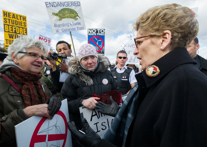 BELLEVILLE, Ont. (02/04/2013) — Kathleen Wynne, Premier of Ontario, speaks with protesters against industrial wind turbine project in Prince Edward County after her visit to a commerce roundtable and a tour at the Procter & Gamble Factory in Belleville, Ont. on Tuesday, April 2, 2013. Photo by Justin Chin