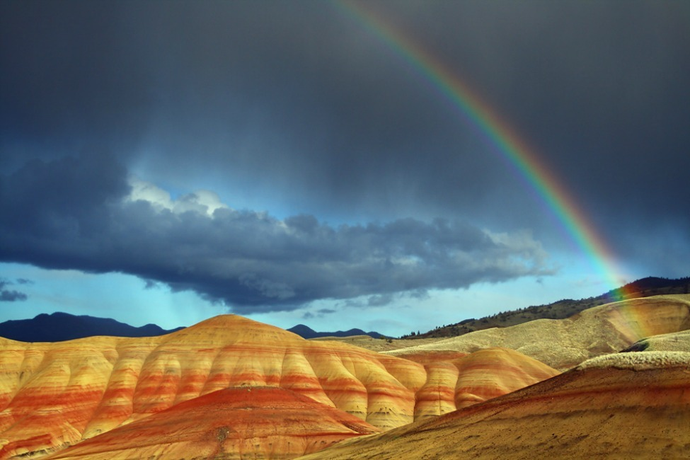 Photo of the Day: A rainbow edges out storm clouds over the Painted Hills in Oregon Photo by Craig Hanson (Corvallis, Oregon); John Day Fossil Beds National Monument, Oregon