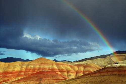 smithsonianmag:  Photo of the Day: A rainbow edges out storm clouds over the Painted Hills in Oregon Photo by Craig Hanson (Corvallis, Oregon); John Day Fossil Beds National Monument, Oregon