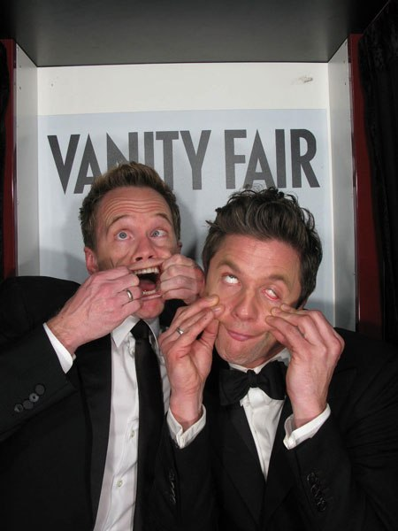 vanityfair:  Neil Patrick Harris and David Burtka inside the Vanity Fair Oscar party photo booth. See more candid photos of the stars here.  Absolutely adorable. Favorite celeb couple.