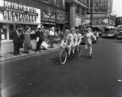 calumet412:  Tandem on State Street at Lake, 1951, Chicago. The Michelob Restaurant seems interesting…