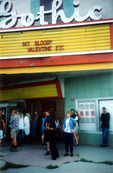 The Gothic in Denver, Colorado. June 1992(moi: last face all the way on the left.) The day of My Bloody Valentine's show happened to coincide with Gay Pride Denver. I left pride – I know my priorities – arrived at the theater four hours before doors opened, and got to meet the band as Kevin (wearing his parka, natch) et al made their way through the front doors. I was pressed against the front of the stage but I held my ground. A metal curtain hung behind the band, strobe lights pulsing in rhythm. Simple yet genius all at once. The sound washed over the crowd and we were all simultaneously baptized. I know that I am, by no means, a maniacal fan of MBV. But I am every bit the devotee.