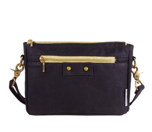 Got a black Danni Mini added to the shop!http://nikolettebags.com/lucy-clutch/danni-waxed-canvas-zip-front-purse-black.html