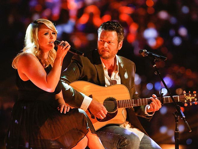 "MIRANDA LAMBERT + BLAKE SHELTON The couple paid tribute to tornado victims on Tuesday with a performance of their record ""Over You"" on THE VOICE. Blake, an Oklahoma native, said after the show, ""I think 'Over You' was the perfect song for this situation. The moment was right."" Salute to them both! What a moving performance. My heart and prayers go out to the victims and the survivors. xo @rozOonTheGo  photo: trae patton"