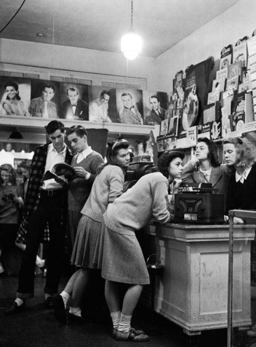 bygoneamericana:  Teenagers at the record store. West Grove, Missouri, 1944. By Nina Leen