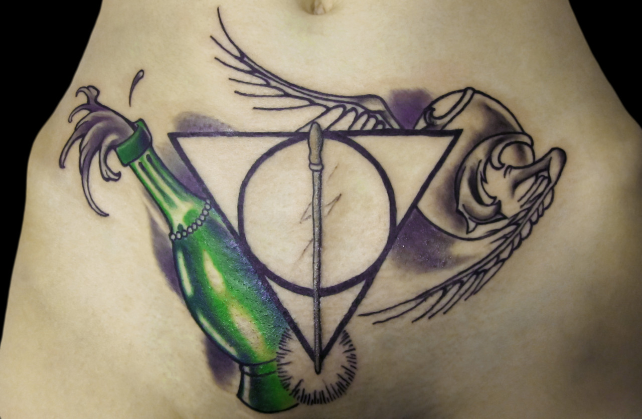 fuckyeahtattoos:  Harry Potter! Polyjuice potion, the Deathly Hallows symbol with Harrry's scar in the center, and the snitch. Beautifully drawn and tattooed in Richmond, VA. Drawing credit: Faith Broache Tattoo credit: Robin Wilcoxson