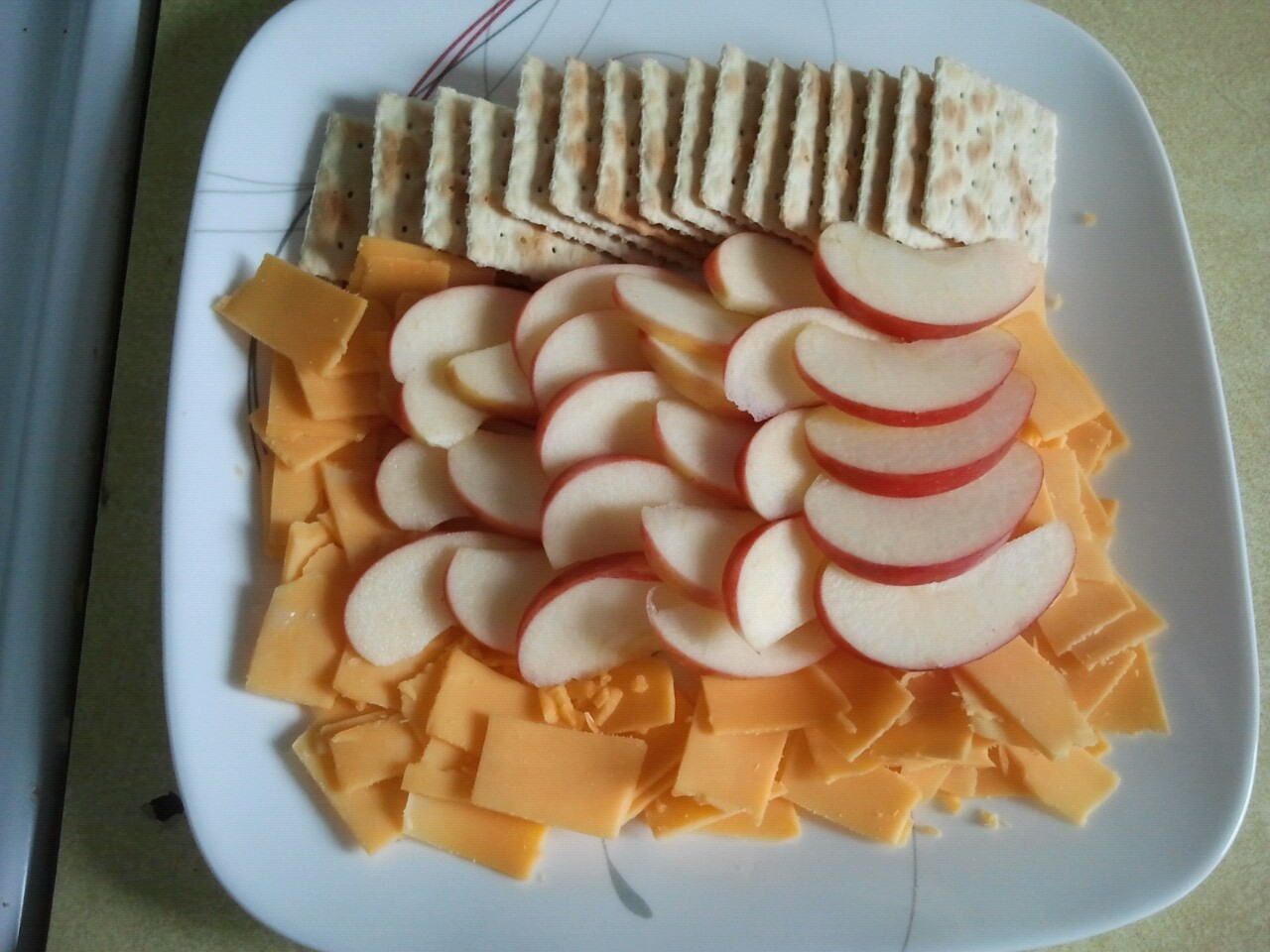 If you slice the apples and cheese thinly enough you can make a decent sized snack for yourself and two children. Each bite carries all the flavor but saves a little money and calories. Throwing in some saltines for between bites will fill you up a little. This is a great way to tide yourself over for another hour or two, until it is time for dinner.