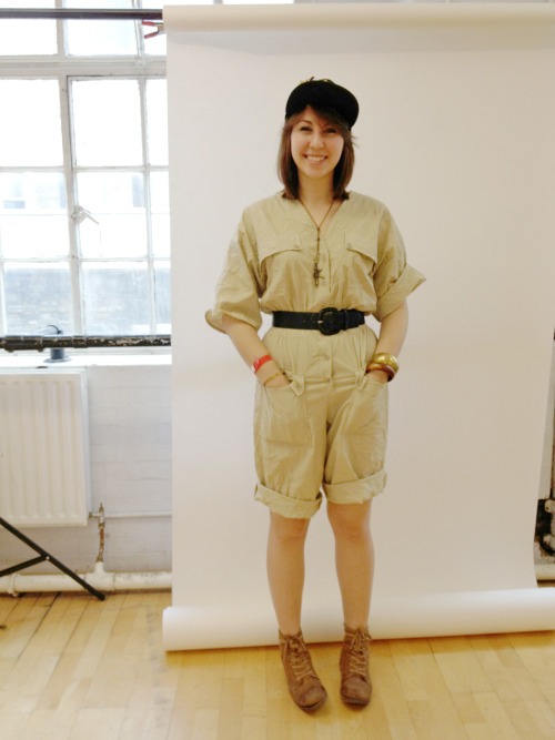 NINA Wears jumpsuit from Beyond Retro, boots by Zigi Girl, belt by Charter Club, cap by Christian Cowan-SanLuis, vintage bracelets and necklace.