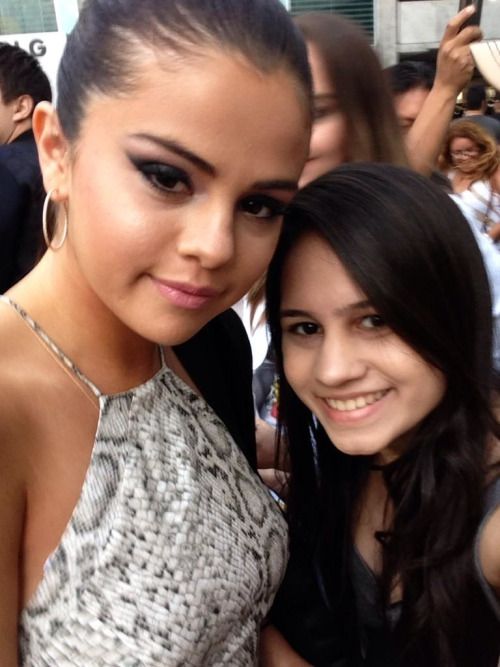 July 29: Selena with a fan at the Behaving Badly premiere