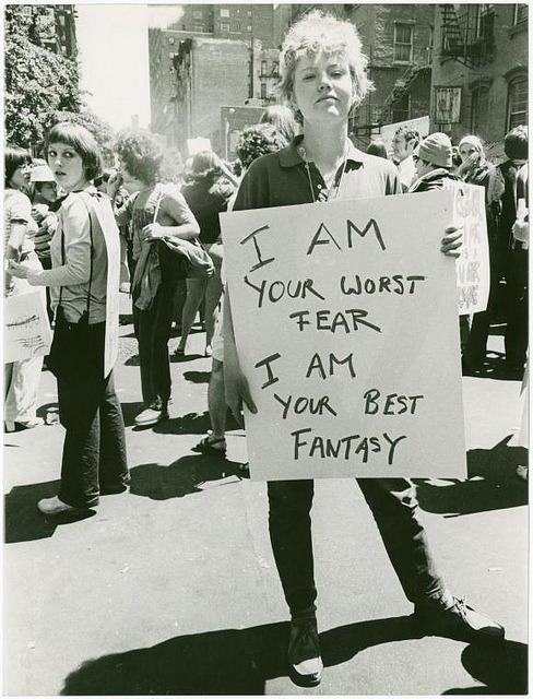 "DONNA GOTTSCHALK HOLDS POSTER ""I AM YOUR WORST FEAR I AM YOUR BEST FANTASY"" AT CHRISTOPHER STREET GAY LIBERATION DAY PARADE, PHOTO BY DIANA DAVIES VIA NYPL"