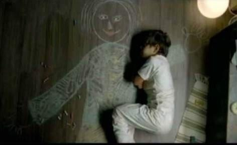 Powerful picture.  An Iraqi boy who lost his mother so he drew himself a mother on the ground and slept next to her.   | via @YourFaceIsHaram