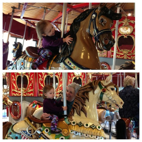 Grace got to ride the carousel twice at the Heritage museum.