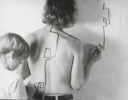 "ch-eap:  ryandonato:  Dennis Oppenheim, Two Stage Transfer Drawing  ""As I run a marker along Eric's s back he attempts to duplicate the movement on the wall. My activity stimulates a kinetic response from his sensory system. I am, therefore, Drawing Through Him.""   absolutely genius"