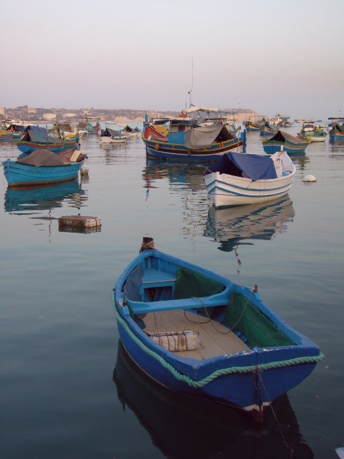 The boats in Marsaxlokk at dusk.