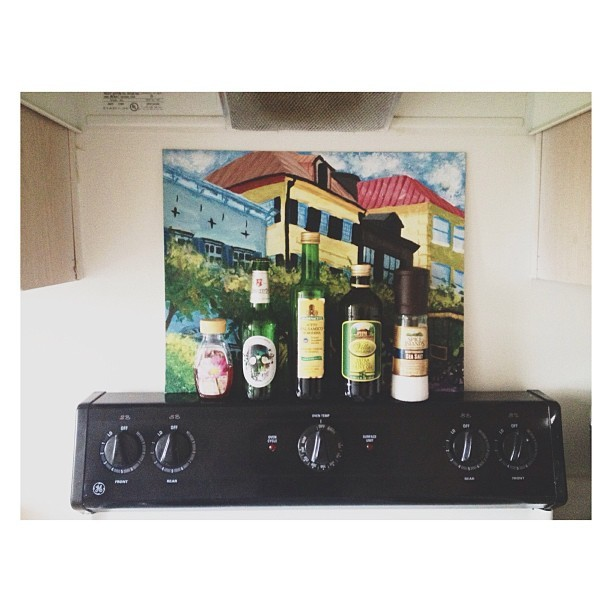 Our stove is cute. Used a painting of rainbow row I painted a while back. 😊