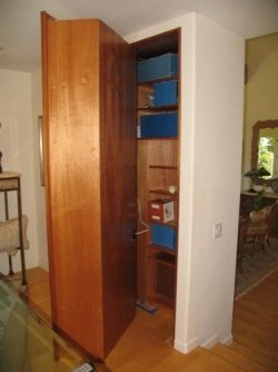 Secret wine rack/bookcase door opens to reveal hidden closet