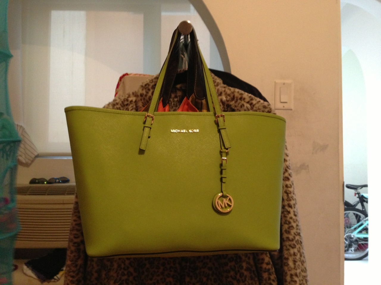 Michael Kors Jet Set Travel Tote is a great big bag. Its size is inbetween the Louis Vuitton MM and GM bag. I love it as an everyday bag and it will also be my number one travel bag. It can carry much more than one thinks and of you're thinking of buying it i really recommended. People tell me all the time that the quality is great and that they are glad that they bought it.   I choose the green color because it's a great color for spring and summer, but I can also mix it up in some winter and fall outfits. I adore the bag, the color, the size, everything, it's a great bag and I thing that it's a great spring bag with a great size.