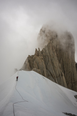 patagonia:  Luminous clouds as Madaleine and I traverse La Silla on the way down from climbing Fitz Roy. Loving life. Photo by  Kate Rutherford