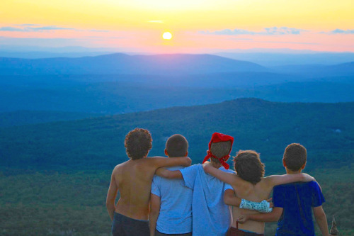 good friends enjoying an amazing sunset while on a hike at Camps Kenwood & Evergreen in NH