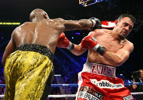 siphotos:  Floyd Mayweather lands a heavy right hand to the face of Robert Guerrero during Saturday's fight in Las Vegas. Mayweather won by decision. (Getty Images) GALLERY: Mayweather Defeats Guerrero
