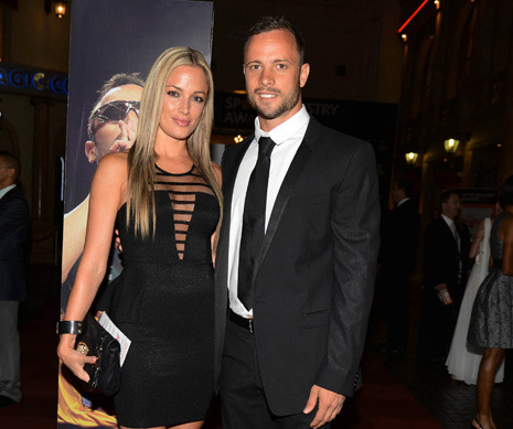 Oscar Pistorius, who ran in the Olympics on carbon-fibre blades, has been arrested and charged with the murder of his girlfriend. Her name was Reeva Steenkamp and she was twenty-nine years old. There has been talk in the press that he mistook her for an intruder, and maybe he did—the investigation is in its first stages…  Amy Davidson on Oscar Pistorius, his girlfriend, and his gun: http://nyr.kr/12OHUnE  Photograph by Thembani Makhubele/Reuters.