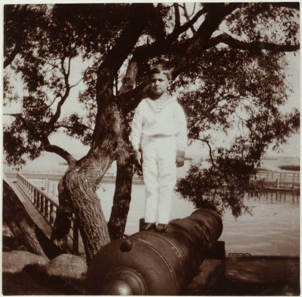 bulletproofjewels:  Alexei posing on top on a canon, around 1910.