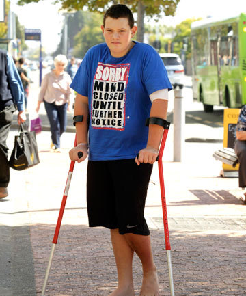 "takealookatyourlife:  [Sassy boy on crutches wearing a shirt that reads ""SORRY MIND CLOSED UNTIL FURTHER NOTICE""] Fourteen-year-old Kaleb Provis had to undergo emergency surgery because of an infection in his knee after a doctor initially told him the pain was possibly caused by his ""morbid obesity"". The infection could have been cured with antibiotics if picked up earlier. ""If it wasn't treated a nurse said his bones would start breaking,"" his mother said Fatness has dangerous implications for your health because of doctors' fat discrimination. Fat does not mean unhealthy.  (link to original story here) As we know, the abuse and under/misdiagnosis of fat people occurs far too often. -ATL"