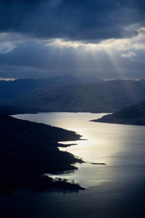travelingcolors:  Rays on a Highland Loch | Scotland (by David May)