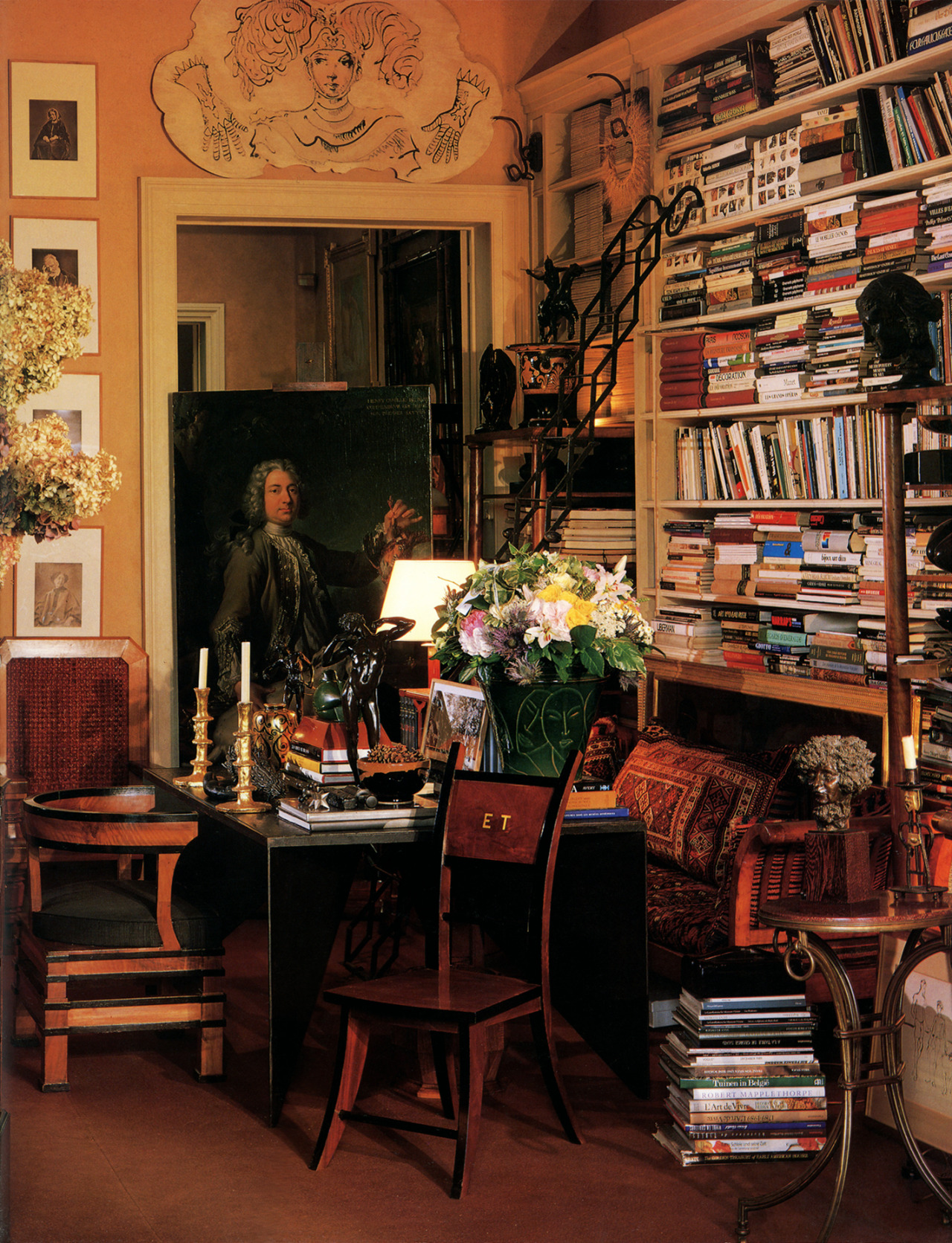 patrickhumphreys:  Jacques Grange's Paris apartment.  [V]iew of the library that leads through from the living room to the dining room. The portrait is 18th century, the drawing over the door is by Bérard, the bronzes are from the 50s and the chair in the foreground was designed by Emilio Terry in the mid-thirties. —Lisa Lovatt-Smith, 1994  Photo by Eric Adjani.
