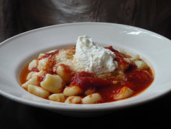 gnocchi in marinara sauce, topped with fresh ricotta. by queenieinmanhattan on Flickr.
