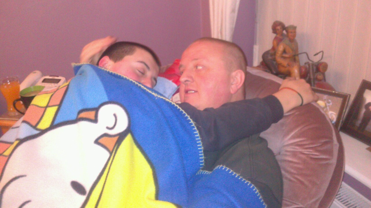 My dad halting a cuddle with my little brother because he doesn't feel well :-)