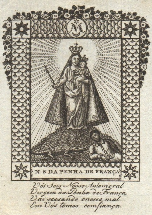 Nossa Senhora da Penha de França A 19th century Portuguese engraving of the miraculous image of Our Lady of Peña de Francia, Spain. According to legend the statue was discovered by the monk Simon Vela after Mary appeared to him in a dream. She told him to go to the mountains, where it had been buried to protect it from destruction by the Moors, who were opposed to the veneration of images. The monk followed Mary's directions and eventually found the statue with the help of some shepherds. He built a small chapel on the site, which soon become a place of pilgrimage. Our Lady of Peña de Francia is usually depicted with a man and a lizard at her feet. One day a pilgrim fell asleep on the side of the road, overcome with fatigue. While he was sleeping a large snake approached him. Before the snake could reach the man a huge lizard jumped over him, as if to warn him. The man woke up and managed to kill the snake before it could attack.