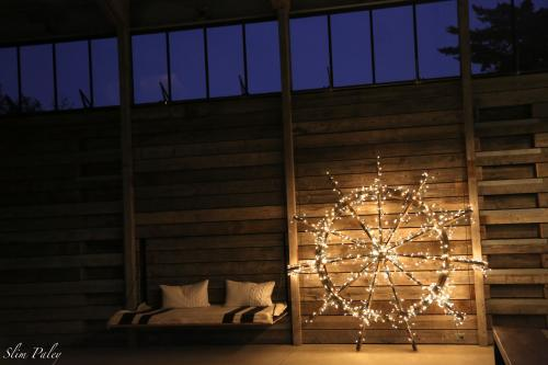 An old water wheel, fairy lights and a barn at Christmas