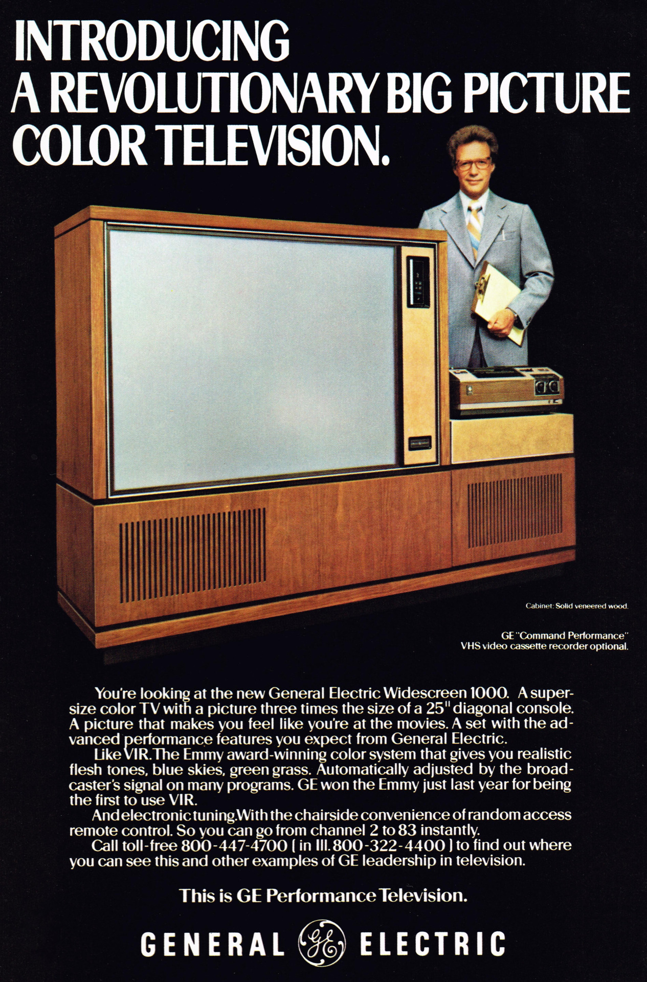 "General Electric Widescreen 1000 TV shown with an optional VHS recorder, 1978. This 75"" TV used magnifying lenses to project a CRT image on the larger format screen. The guy with the clipboard reminds me of a Saturday Night Live skit."