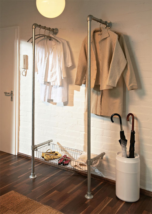 storagegeek:  DIY : Simple Clothing Rack : Simplified Building This super simple clothing rack is also super affordable. We've been talking about something similar to this for an entry way storage option. I like how the hangers would hang parallel to the wall. Yup.