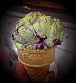 One of our most popular, beautiful and daring Ice Creams, Blueberry Kale, shown here in a Cake Cone :)
