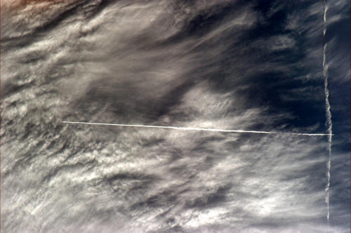 This space picture brought to you by the letter T. Contrails, as-seen from orbit.