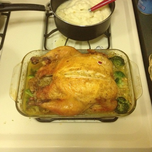 #masterpiece finally done #RoastedChicken bathed in broccoli, rice, and chicken broth; mashed potatoes and corn on the side… I'd like to think I've done it again