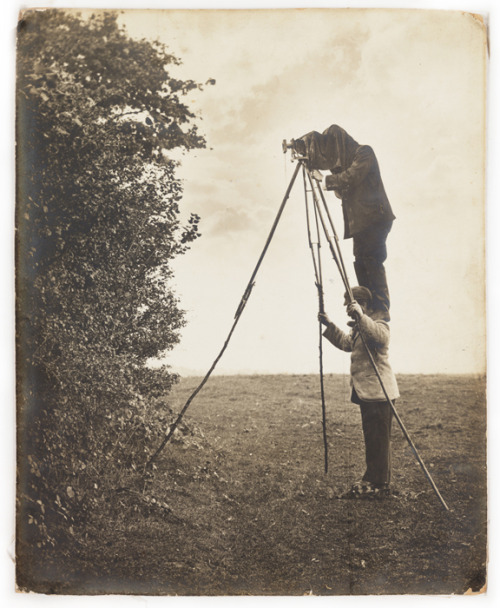 © Cherry Kearton, 1900, Wildlife photography pioneers Cherry stands on Richard's shoulders to take a picture of a bird's nest. Richard and Cherry Kearton introduced the 'hide' method of bird-watching and photography. The brothers were pioneers of wildlife photography, producing their book 'With Nature and a Camera' illustrated with a 160 photographs in 1899, written by Richard with photographs by Cherry.  Richard Kearton (1862 - 1928) moved to London from Yorkshire in 1882 to work for Cassell's publishing house. worked with his brother Cherry Kearton, their book 'With Nature and a Camera', was published in London by Cassell & Co in 1899. Cherry Kearton (1871 - 1940) was a photographer and documentary film maker of animals and nature; film director; set up his own film company producing natural history and expedition films. » find more photobooks here «