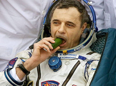 Soyuz TMA-18 cosmonaut Mikhail Kornienko eats cucumber after landing in Kazakh steppes near town of Arkalyk, in central Kazakhstan, 25 September 2010