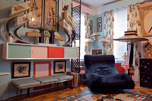 "whistlebait138:  hellahaus:  tammytrasho:  avalonmonet:  midcenturymodernfreak:  The Crown Prince of Kitsch Cullen Meyer is only 27 and has been collecting/hoarding the wildest 1950s ""The Dead 50s"" kitsch since he was 15. He lives in a (limited sq. footage) New York apartment and wishes he had a 1950s house. The stuff you see here is not all of it. Cullen's got at least 50 more moss lamps (lighting is his favorite) and tons of other period pieces in storage! Part of his job is going to every major flea market and antique show in the country and eventually wants to get into set design for movies. (Photos: Paul Quitoriano)      Can I please live here!?!"