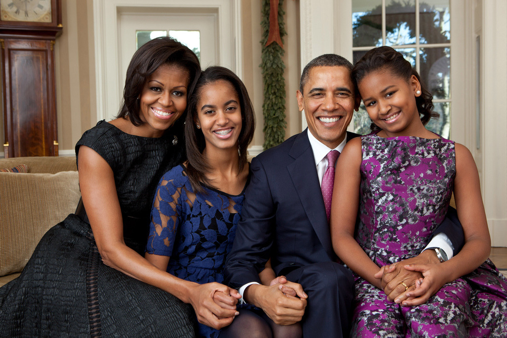 "Dec. 11, 2011 ""For a new family portrait, I chose a sofa in the Oval Office mostly because the State Floor was busy with tours for the Christmas holiday. Since portraiture is not my strong suit, I tried to make the setup as simple as possible."" (Official White House Photo by Pete Souza)   Most iconic Pete Souza photos of Obama family's first 4 years in the White House"